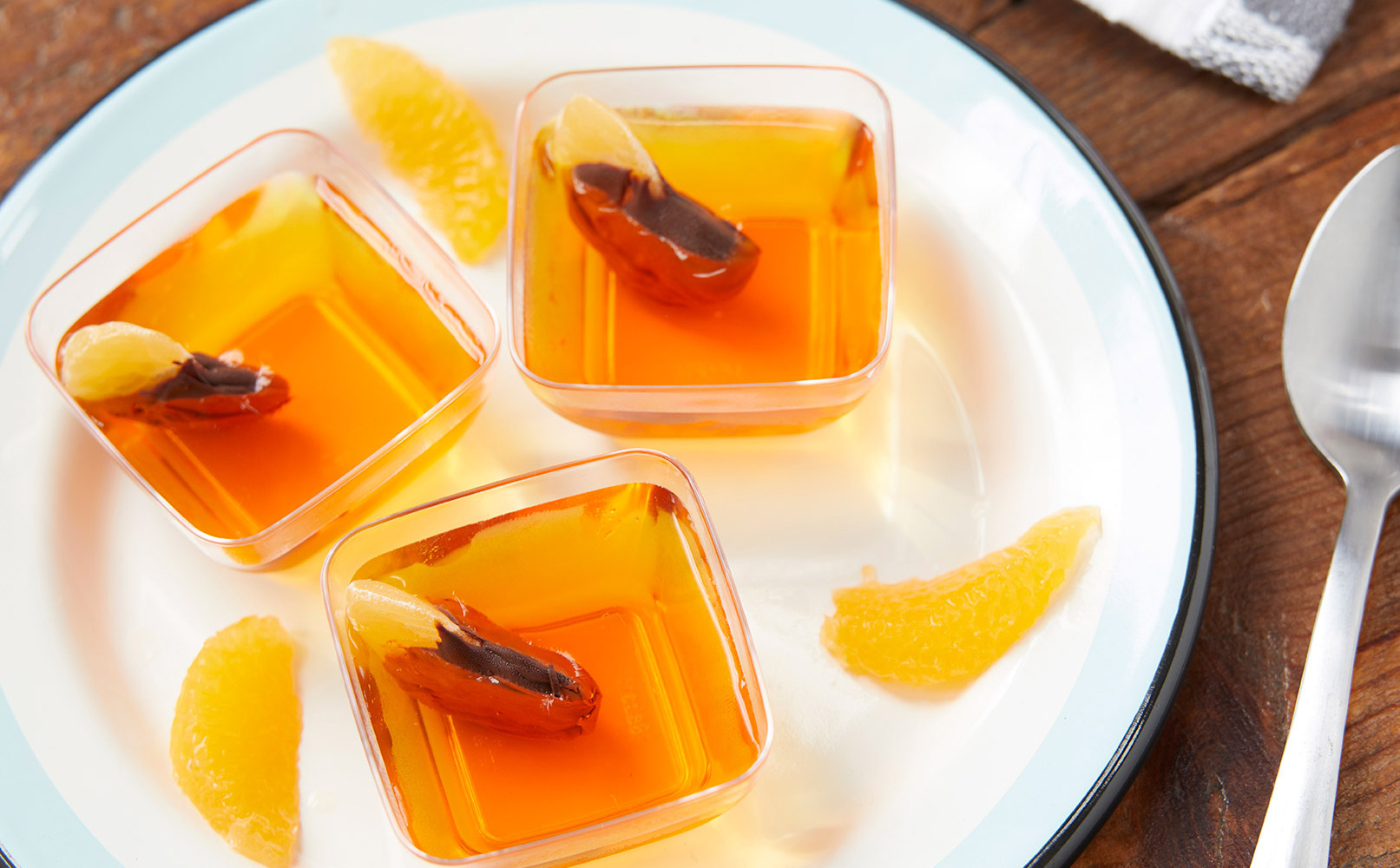 Orange Gelatin Dessert cup topped with Dark Chocolate